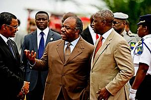 President Ali Bongo Ondimba of Gabon at the burning of ivory President Ali Bongo Ondimba of Gabon speaks with the Gabon prime minister at the burning of Gabon's poached Ivory stock pile, Libreville, Gabon, 27th June 2012.