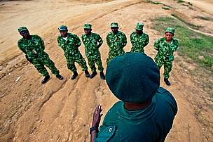 Anti poaching patrol, Gabon Parcs Gabon Eco guards under the authority of ANPN - the national parks agency - are briefed before going on patrol to Menkebe national park, Gabon. Anti poaching patrols can often take as long as two week in the forest.