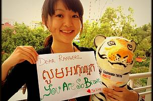 Jialing of Singapore on assignment in Cambodia seen here with WWF Cards4Tigers for Cambodian rangers