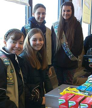 Medford girl scouts sell cookies to help save endangered species.