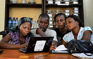 Local community members in Mai-Ndombe, DRC receive computer training on MRV.